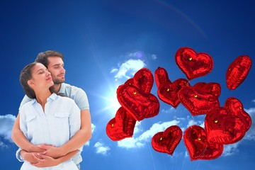 Composite image of cute couple embracing with eyes closed