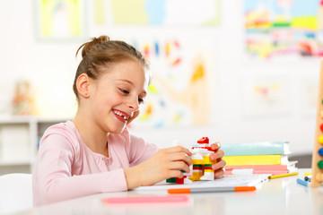 Little girl is doing homework at home