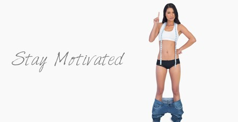 Smart woman wearing jeans falling down because shes lost weight