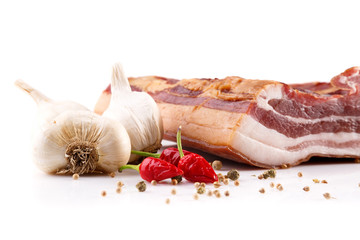 Garlic and bacon isolated on white background