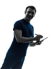 man holding digital tablet and pen  silhouette