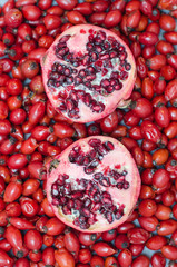Rose-hip berries and two halves pomegranate