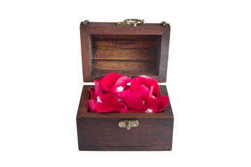 red rose petal in an old wood chest