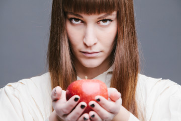 Woman's hands holding a red apple
