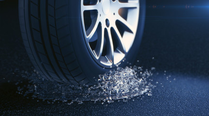 car tire with water splash. Depth of field blur