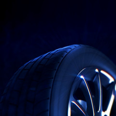 macro of a car tire with depth of field blur on black background