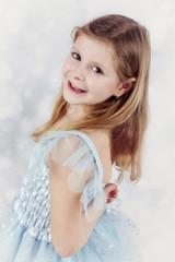 Beautiful little girl in blue princess dress