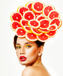 Beautiful woman with grapefruit slices. Citrus. Perfect skin. Pr