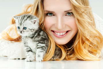 Beautiful young woman and her little kitten. Cute kitten.