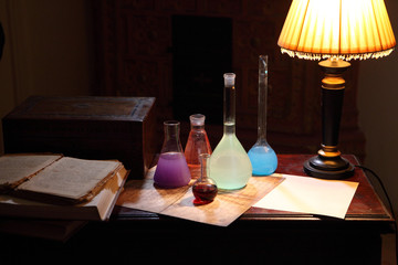 Table of the chemist, the book and flask for chemical experiment