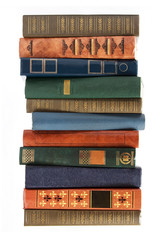 Stack of antique books isolated on white background