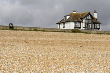 shingle beach and old cottage at New Romney