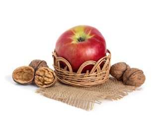 Apple and nuts in basket isolated on white