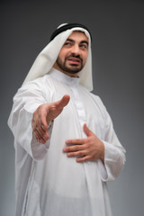 Arab business man stretching out his hand