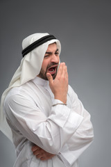 Arab man raising his hands being tired