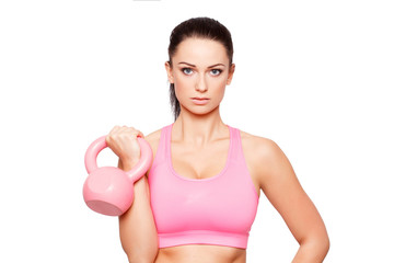 Young sporty woman with kettlebell