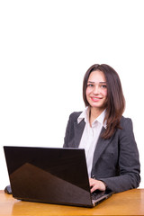 young business woman at a table with a laptop