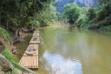 bamboo raft floating in river