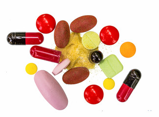 Many color pills  on white background