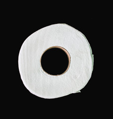 toilet paper isolated on black