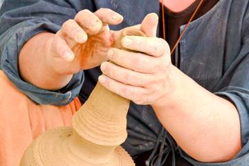 hands making earthenware
