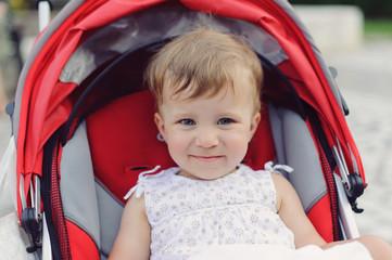 Smiling Baby in Stroller