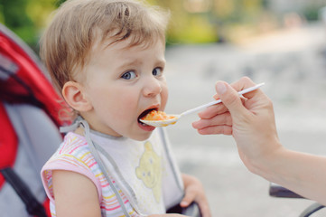 Mother Feeding Girl