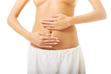 Woman massaging slim belly