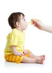 baby feeding isolated on white
