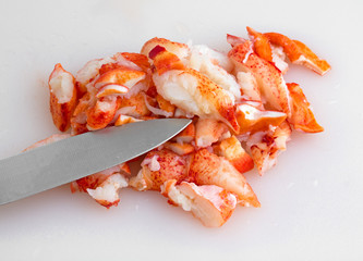 Lobster on a cutting board with a knife