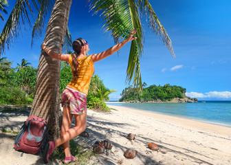Tourist girl enjoying view of beautiful  island and beach.