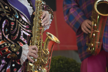 clown hands playing sax