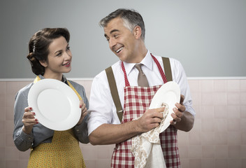 Vintage couple dish washing together
