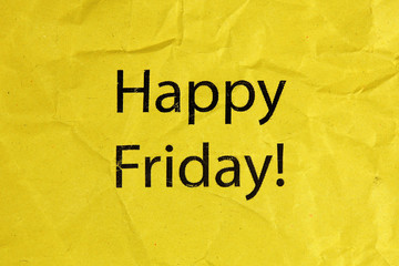 happy friday text on yellow crumpled paper