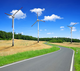 Asphalted road with wind turbines