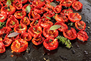 Sun dried tomatoes with olive oil and herbs