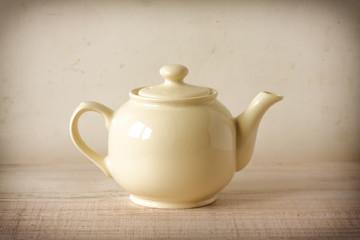 Vintage cream teapot in retro decor