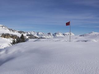 Alpine winter landscape with sunshine