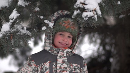 Cute kid under the Christmas tree