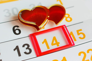 Date February 14 marked on the calendar. Two hearts