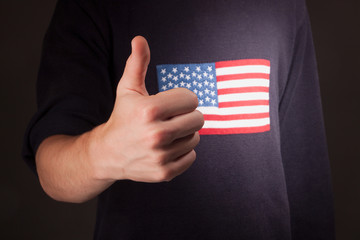 thumbs up gesture with american flag