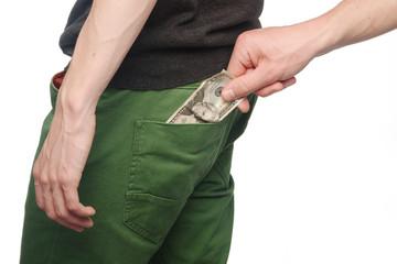 Pickpocket stealing a mans money from back pocket