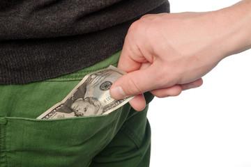 Pickpocket stealing money from back pocket