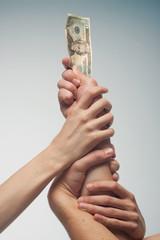 hands fighting for money