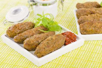 Koftas - Lamb koftas served with harissa. Middle Eastern meal!
