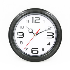 Black and white round wall clock isolated on white background.