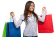 Smiling black woman holding shopping bags