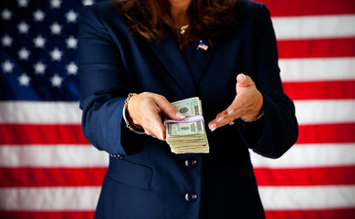 Politician: Holding a Stack of Cash