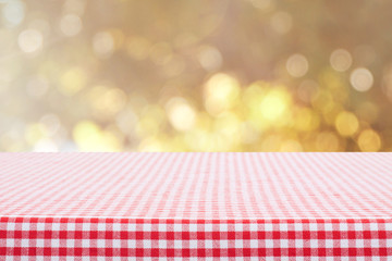 checkerboard table with yellow sparkle bokeh background