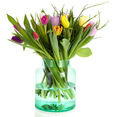 Tulips in green glass vase